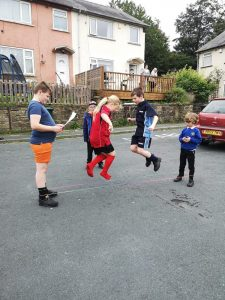 Get Out More Street Support Session with Keighley Children playing traditional skipping games